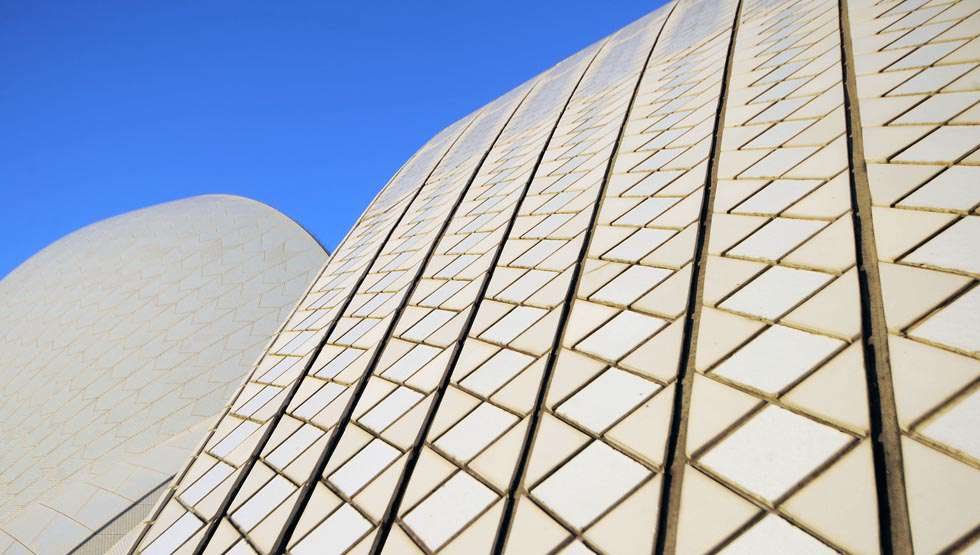 Utzon needed the tiles to be glossy, but not too mirror-like. It took Swedish manufacturer Hoganas three years to produce the desired effect. The so-called Sydney tile was made from clay with a small percentage of crushed stone.